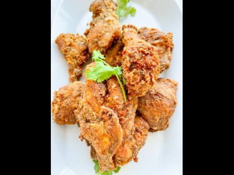 One bite of this jerked fried chicken will leave you wanting seconds.