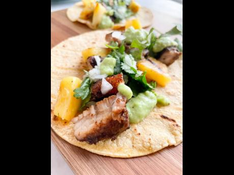A lover of Mexican food, Yanikie Tucker created these jerked pork tacos with grilled pineapples and tomatillo avocado crema.