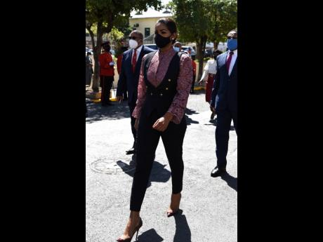 With a 'vested interest' in the country, Lisa Hanna, member of parliament for St Ann South Eastern, strutted into Gordon House as a picture of power and elegance. Her extensive and fabulous closet is credited for this ensemble.