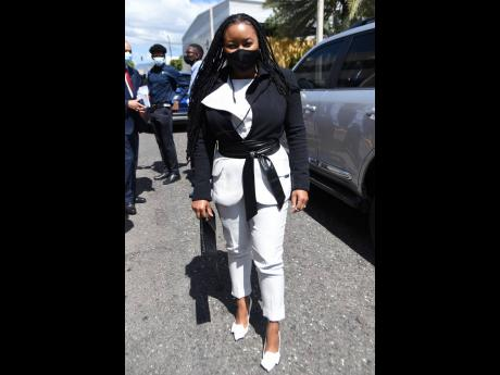 Excited to be participating in the Ceremonial Opening of Parliament for the first time, Member of Parliament for Trelawny Northern Tova Hamilton rocked this dynamic black and white power suit.
