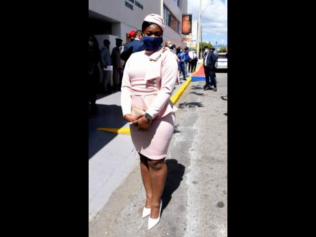 Opposition Senator Gabriela Morris donned a delicate form-fitting light pink peplum dress designed by Norma Powell.