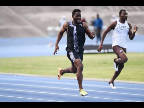 Rusheen McDonald (left) winning the men's 400m in a time of 46.49 seconds at the Velocity Fest track meet held at the National Stadium on Saturday, August 8, 2020.