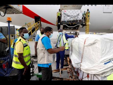This photograph, released by UNICEF yesterday, shows the first shipment of COVID-19 vaccines distributed by the COVAX Facility arriving at the Kotoka International Airport in Accra, Ghana. Ghana has become the first country in the world to receive vaccines