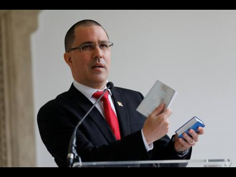 Venezuelan Foreign Minister Jorge Arreaza gives a news conference at his office moments after he met with European Union Ambassador to Venezuela Isabel Brilhante Pedrosa to give her a letter of 'persona non grata', and giving her 72 hours to leave the