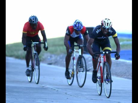 Dr Wayne Palmer (right) competing at a Jamaica Cycling Federation development meet held at the National Stadium on Sunday, February 11, 2018.