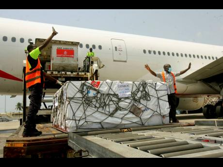 A shipment of COVID-19 vaccines distributed by the COVAX Facility arrives in Abidjan, Ivory Coast yesterday.