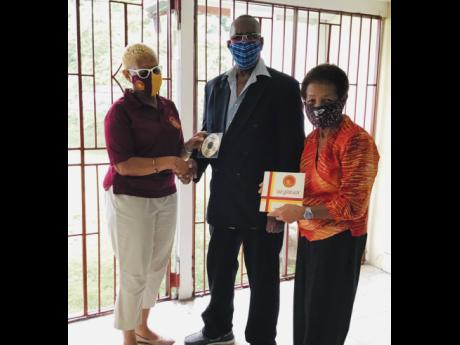 From left: Yolette Barnett, president of Wolmer's Girls' Alumnae; Neville Hinds, engineer for the recording of the song; and Norma Brown Bell, producer.