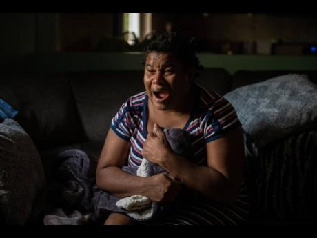 A grieving Narda McKoy retraces the circumstances that led to her daughter's death during an interview at her Bedward Gardens, St Andrew, home on Sunday. McKoy said that Jalisa McGowan died after healthcare workers allegedly failed to offer medical assis