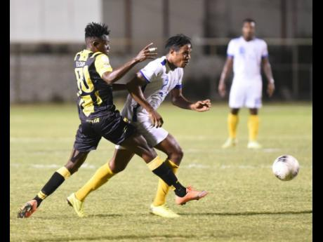 Stephen Williams (right) from Waterhouse dribbles away from Elliader Dorius (left) from Don Bosco from Haiti during their Concacaf Club football match at the Anthony Spaulding Sports Complex on Sunday, February 2, 2020.