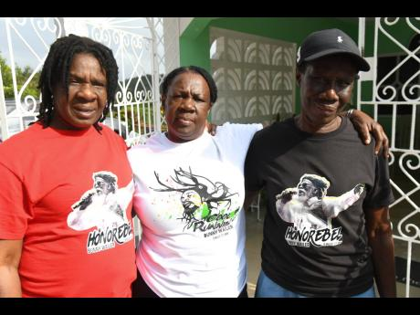 Sisters of the late Neville Livingston, more popularly known as Bunny Wailer, gather in his Nine Miles hometown in St Ann on Tuesday. From left are Claudette Livingston, who is also the sister of the late Bob Marley; Vinette Robb-Oddman and Monica Robb.