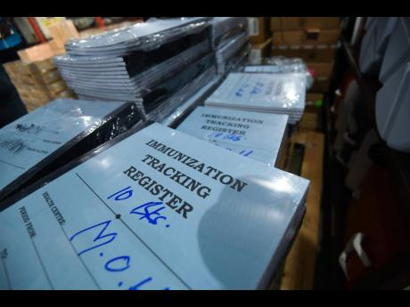 Immunisation registers are seen at the warehouse in Vineyard Town, St Andrew, where syringes and other vaccination equipment are being stored.