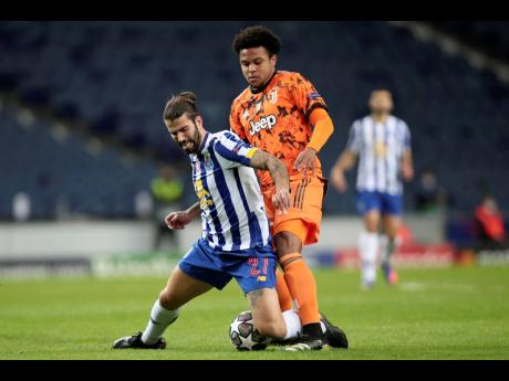 Juventus' Weston McKennie (right) vies for the ball with Porto's Sergio Oliveira during the Champions League round of 16, first leg match between FC Porto and Juventus at the Dragao stadium in Porto, Portugal, Wednesday, February 17, 2021.