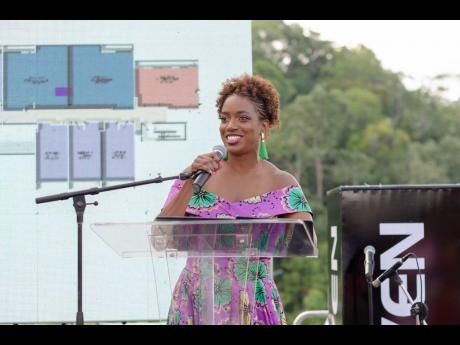 File  Aisha Campbell, CEO of Proven REIT Limited, speaking at the launch of one of the company's real estate projects  in Mandeville.