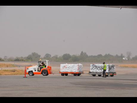 AP  COVID-19 vaccines are offloaded from a plane at Lagos airport, Tuesday March 2, 2021. Nigeria received vaccines acquired through the United Nations-backed COVAX initiative with a delivery of the AstraZeneca vaccine made by the Serum Institute of India.