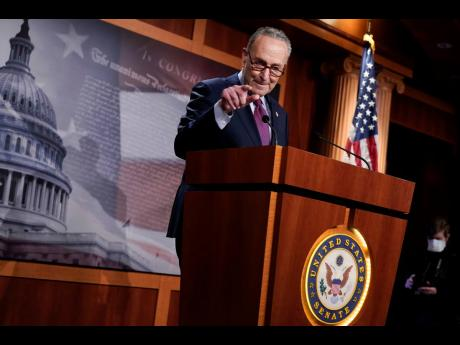 Senate Majority Leader Chuck Schumer speaking during a news conference after the Senate passed a COVID-19 relief bill in Washington on Saturday.