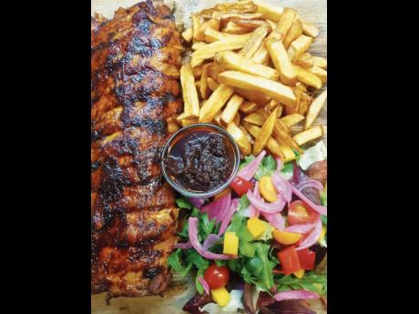 1. Pinder's Café  ribs is served with  fries and a salad.
