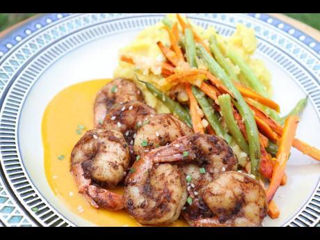 Jerked shrimp, with a silky pumpkin sauce, Parmesan garlic vegetables and sweet potato mash.