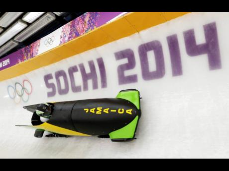 The JAM-1 sled from Jamaica takes a turn during a training run for the men's two-man bobsled at the 2014 Winter Olympics in February 2014 in Krasnaya Polyana, Russia.