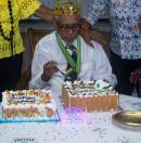 The 'King' Professor Keith Barrington Jones about to cut his cake.