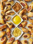 Pigs in blankets with mustard sauces is a popular hors d'oeuvre.
